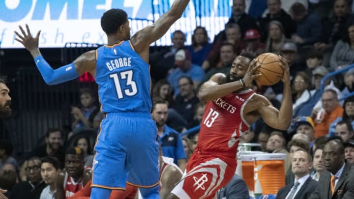 OKLAHOMA CITY, OK - NOVEMBER 8: James Harden #13 of the Houston Rockets tries to shoot around Paul George #13 of the Oklahoma City Thunder during the first half of a NBA game at the Chesapeake Energy Arena on November 8, 2018 in Oklahoma City, Oklahoma. NOTE TO USER: User expressly acknowledges and agrees that, by downloading and or using this photograph, User is consenting to the terms and conditions of the Getty Images License Agreement. (Photo by J Pat Carter/Getty Images)