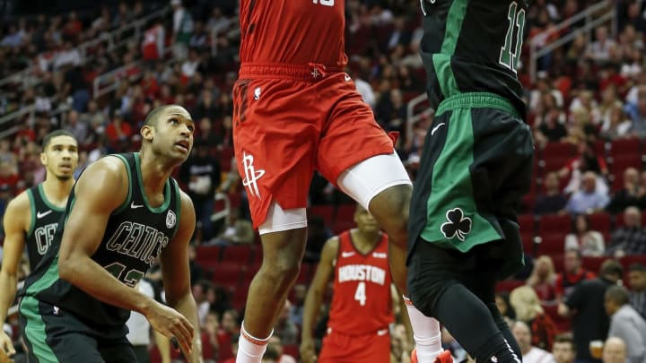 HOUSTON, TX – DECEMBER 27: James Harden #13 of the Houston Rockets goes up for a lay up defended by Kyrie Irving #11 of the Boston Celtics in the second half at Toyota Center on December 27, 2018 in Houston, Texas. NOTE TO USER: User expressly acknowledges and agrees that, by downloading and or using this photograph, User is consenting to the terms and conditions of the Getty Images License Agreement. (Photo by Tim Warner/Getty Images)