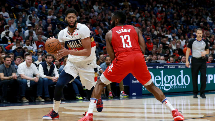 NEW ORLEANS, LOUISIANA – DECEMBER 29: Anthony Davis #23 of the New Orleans Pelicans is defended by James Harden #13 of the Houston Rockets during a NBA game at the Smoothie King Center on December 29, 2018 in New Orleans, Louisiana. NOTE TO USER: User expressly acknowledges and agrees that, by downloading and or using this photograph, User is consenting to the terms and conditions of the Getty Images License Agreement. (Photo by Sean Gardner/Getty Images)