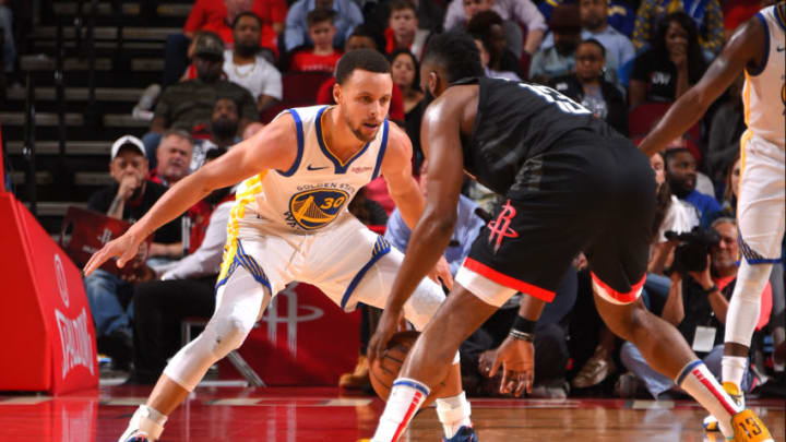Stephen Curry #30 of the Golden State Warriors defends against James Harden #13 of the Houston Rockets (Photo by Bill Baptist/NBAE via Getty Images)