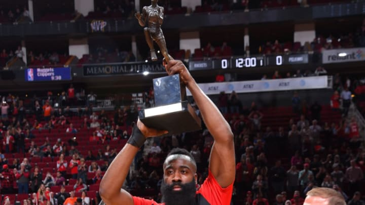 HOUSTON, TX - OCTOBER 17: James Harden #13 of the Houston Rockets is presented the Maurice Podoloff Trophy for MVP by Tilman Fertitta during a game on October 17, 2018 at Toyota Center, in Houston, Texas. NOTE TO USER: User expressly acknowledges and agrees that, by downloading and/or using this Photograph, user is consenting to the terms and conditions of the Getty Images License Agreement. Mandatory Copyright Notice: Copyright 2018 NBAE (Photo by Bill Baptist/NBAE via Getty Images)
