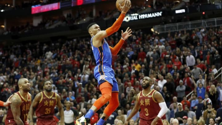 Russell Westbrook #0 of the Oklahoma City Thunder goes up for a lay up in the fourth quarter defended by Chris Paul #3 of the Houston Rockets and PJ Tucker #17 (Photo by Tim Warner/Getty Images)