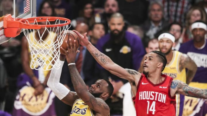 LeBron James #23 of the Los Angeles Lakers goes for a layup against Gerald Green #14 of the Houston Rockets (Photo by Yong Teck Lim/Getty Images)