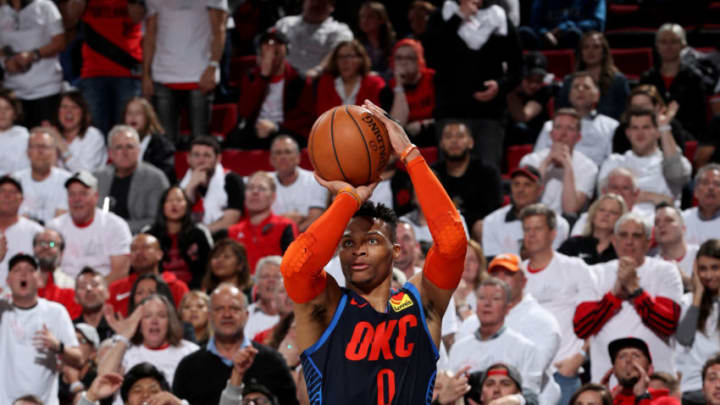 PORTLAND, OR - APRIL 23: Russell Westbrook #0 of the Oklahoma City Thunder shoots a three point basket during the game against the Portland Trail Blazers during Game Five of Round One of the 2019 NBA Playoffs on April 23, 2019 at the Moda Center in Portland, Oregon. NOTE TO USER: User expressly acknowledges and agrees that, by downloading and or using this Photograph, user is consenting to the terms and conditions of the Getty Images License Agreement. Mandatory Copyright Notice: Copyright 2019 NBAE (Photo by Zach Beeker/NBAE via Getty Images)