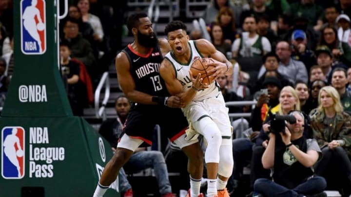 Giannis Antetokounmpo #34 of the Milwaukee Bucks is defended by James Harden #13 of the Houston Rockets (Photo by Stacy Revere/Getty Images)