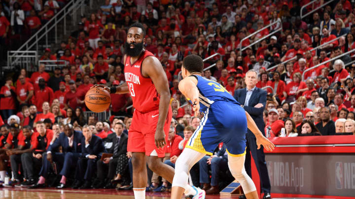 James Harden #13 of the Houston Rockets handles the ball against Stephen Curry #30 of the Golden State Warriors (Photo by Andrew D. Bernstein/NBAE via Getty Images)