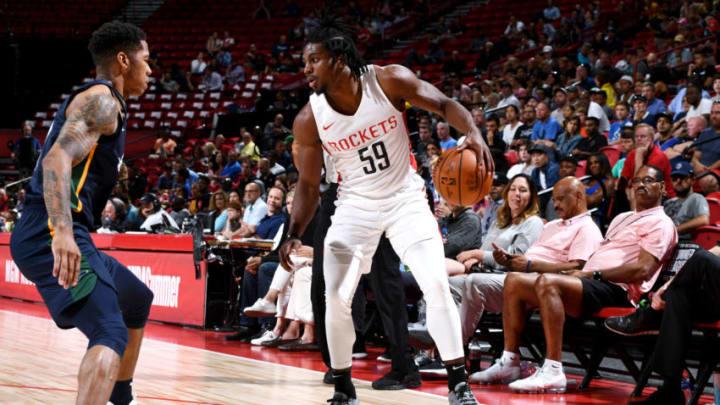 Chris Clemons #59 of the Houston Rockets handles the ball against the Utah Jazz (Photo by Garrett Ellwood/NBAE via Getty Images)