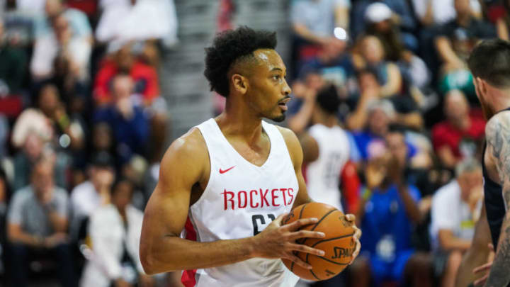 Johnathan Williams #61 of the Houston Rockets handles the ball during a game against the Dallas Mavericks at NBA Summer League (Photo by Cassy Athena/Getty Images)