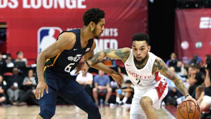 Chris Chiozza #2 of the Houston Rockets drives against Isaiah Cousins #6 of the Utah Jazz (Photo by Ethan Miller/Getty Images)