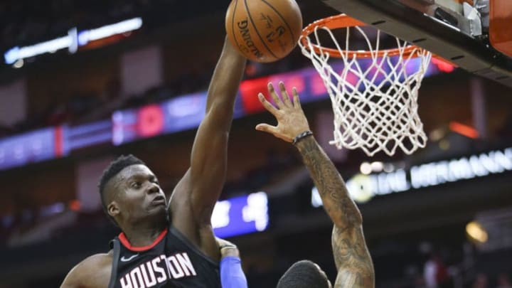 D.J. Augustin #14 of the Orlando Magic has his shot blocked by Clint Capela #15 of the Houston Rockets (Photo by Bob Levey/Getty Images)