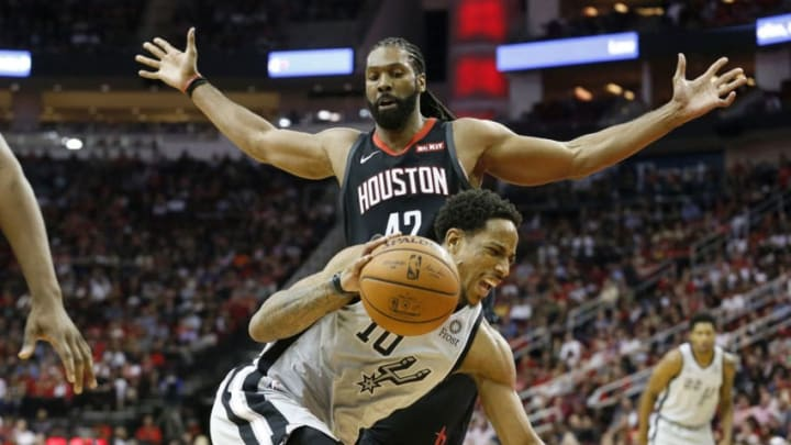 DeMar DeRozan #10 of the San Antonio Spurs drives to the basket defended by Nene Hilario #42 of the Houston Rockets (Photo by Tim Warner/Getty Images)