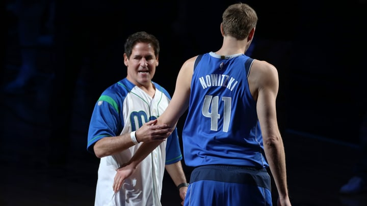 DALLAS, TX – APRIL 09: Dirk Nowitzki #41 of the Dallas Mavericks hugs Mark Cuban after announcing that he played his last home game at American Airlines Center on April 09, 2019 in Dallas, Texas. NOTE TO USER: User expressly acknowledges and agrees that, by downloading and or using this photograph, User is consenting to the terms and conditions of the Getty Images License Agreement. (Photo by Omar Vega/Getty Images)
