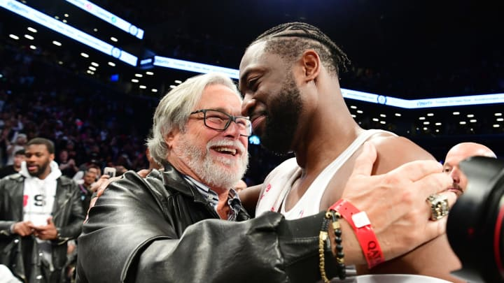 NEW YORK, NEW YORK – APRIL 10: Dwyane Wade #3 of the Miami Heat hugs Miami Heat owner Micky Arison after the game against the Brooklyn Nets at Barclays Center on April 10, 2019 in the Brooklyn borough of New York City. This was Wade's last NBA game before retirement. NOTE TO USER: User expressly acknowledges and agrees that, by downloading and or using this photograph, User is consenting to the terms and conditions of the Getty Images License Agreement.(Photo by Sarah Stier/Getty Images)