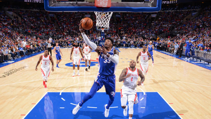 Robert Covington #33 of the Philadelphia 76ers goes to the basket against the Houston Rockets (Photo by Jesse D. Garrabrant/NBAE via Getty Images)