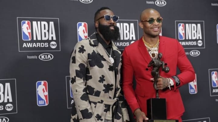 James Harden #13 of the Houston Rockets poses for a photo with PJ Tucker #4 of the Houston Rockets (Photo by Will Navarro/NBAE via Getty Images)