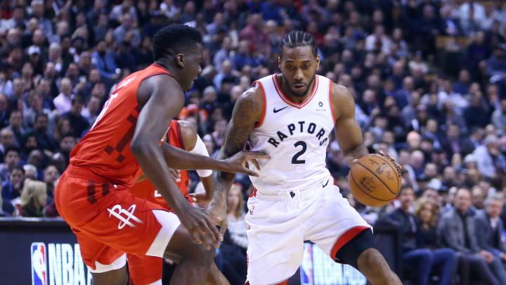 TORONTO, ON – MARCH 5: Kawhi Leonard #2 of the Toronto Raptors dribbles the ball as Clint Capella #15 of the Houston Rockets defends during the first half of an NBA game at Scotiabank Arena on March 5, 2019 in Toronto, Canada. NOTE TO USER: User expressly acknowledges and agrees that, by downloading and or using this photograph, User is consenting to the terms and conditions of the Getty Images License Agreement. (Photo by Vaughn Ridley/Getty Images)