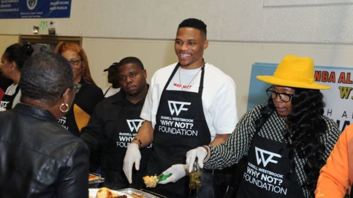LOS ANGELES, CA - NOVEMBER 21: (L-R) Raynard Westbrook, Russell Westbrook and Shannon Westbrook attend Russell Westbrook Why Not? Foundation 8th Annual Thanksgiving Dinner at Jesse Owens Community Regional Park on November 21, 2019 in Los Angeles, California. (Photo by Joshua Blanchard/Getty Images for Russell Westbrook Why Not? Foundation )
