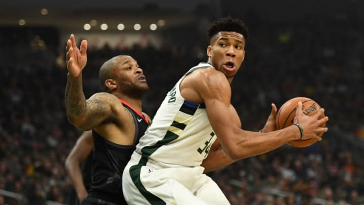 MILWAUKEE, WISCONSIN - MARCH 26: Giannis Antetokounmpo P.J. Tucker (Photo by Stacy Revere/Getty Images)