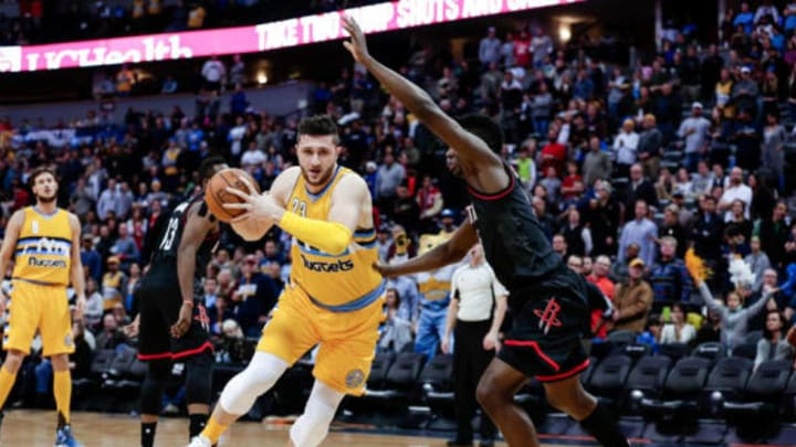 Dec 2, 2016; Denver, CO, USA; Houston Rockets center Clint Capela (15) guards Denver Nuggets center Jusuf Nurkic (23) in the first quarter at the Pepsi Center. Mandatory Credit: Isaiah J. Downing-USA TODAY Sports