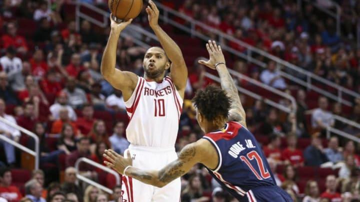 Jan 2, 2017; Houston, TX, USA; Houston Rockets guard Eric Gordon (10) shoots the ball during the second quarter as Washington Wizards forward