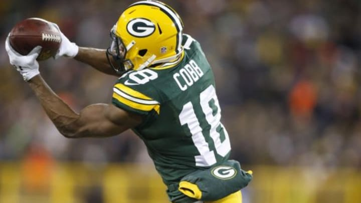 Nov 30, 2014; Green Bay, WI, USA; Green Bay Packers wide receiver Randall Cobb (18) catches a pass during the second half against the New England Patriots at Lambeau Field. The Packers won 26-21. Mandatory Credit: Chris Humphreys-USA TODAY Sports