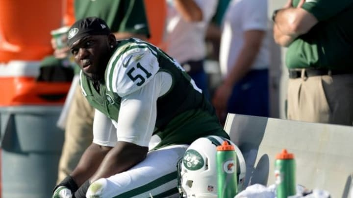 Dec 28, 2014; Miami Gardens, FL, USA; New York Jets linebacker IK Enemkpali (51) takes a breather on the bench during the second half against the Miami Dolphins at Sun Life Stadium. Mandatory Credit: Steve Mitchell-USA TODAY Sports