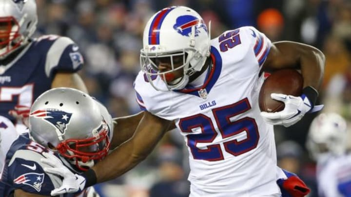 Nov 23, 2015; Foxborough, MA, USA; Buffalo Bills running back LeSean McCoy (25) tries to shed New England Patriots middle linebacker Jerod Mayo (51) during the first half at Gillette Stadium. Mandatory Credit: Winslow Townson-USA TODAY Sports