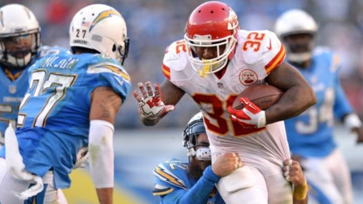 Nov 22, 2015; San Diego, CA, USA; Kansas City Chiefs running back Spencer Ware (32) runs as San Diego Chargers free safety Eric Weddle (32) and strong safety Jimmy Wilson (27) defend during the fourth quarter at Qualcomm Stadium. Mandatory Credit: Jake Roth-USA TODAY Sports