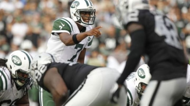 Nov 1, 2015; Oakland, CA, USA; New York Jets quarterback Geno Smith (7) stands behind center against the Oakland Raiders in the third quarter at O.co Coliseum. The Raiders defeated the Jets 34-20. Mandatory Credit: Cary Edmondson-USA TODAY Sports