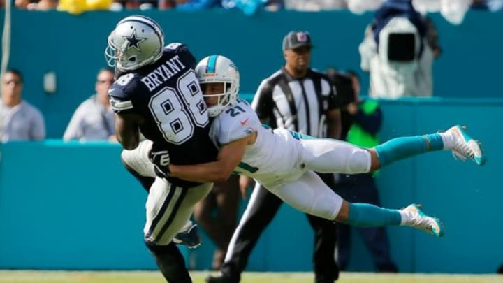 Nov 22, 2015; Miami Gardens, FL, USA; Dallas Cowboys wide receiver Dez Bryant (88) is tackled by Miami Dolphins cornerback Brent Grimes (21) during the first half at Sun Life Stadium. Mandatory Credit: Steve Mitchell-USA TODAY Sports