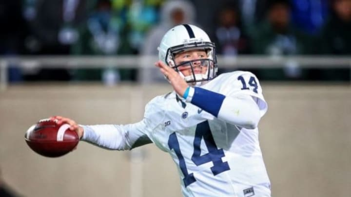 Nov 28, 2015; East Lansing, MI, USA; Penn State Nittany Lions quarterback Christian Hackenberg (14) attempts to pass the ball against the Michigan State Spartans during the 2nd half game of a game at Spartan Stadium. Mandatory Credit: Mike Carter-USA TODAY Sports