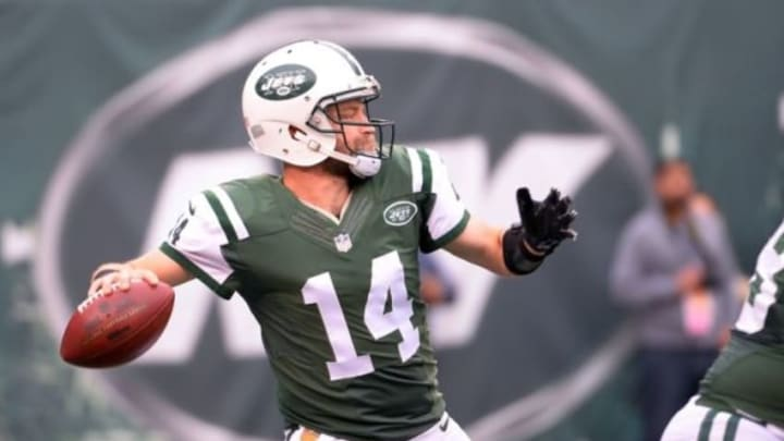 Dec 27, 2015; East Rutherford, NJ, USA; New York Jets quarterback Ryan Fitzpatrick (14) throws a pass during the first quarter against the New England Patriots at MetLife Stadium. Mandatory Credit: Robert Deutsch-USA TODAY Sports