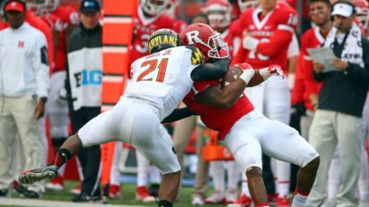 Nov 28, 2015; Piscataway, NJ, USA; Maryland Terrapins defensive back Sean Davis (21) tackles Rutgers Scarlet Knights wide receiver Janarion Grant (1) during the second half at High Points Solutions Stadium. Maryland defeated Rutgers 46-41. Mandatory Credit: Ed Mulholland-USA TODAY Sports