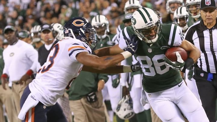 Sep 22, 2014; East Rutherford, NJ, USA; New York Jets wide receiver David Nelson (86) holds off Chicago Bears cornerback Kyle Fuller (23) during the third quarter at MetLife Stadium. Chicago Bears won 27-19. Mandatory Credit: Anthony Gruppuso-USA TODAY Sports