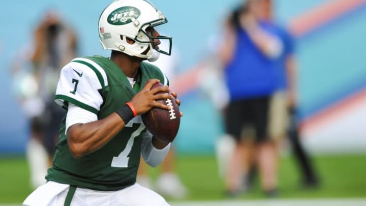 Dec 28, 2014; Miami Gardens, FL, USA; New York Jets quarterback Geno Smith (7) drops back to pass against the Miami Dolphins during the first half at Sun Life Stadium. Mandatory Credit: Steve Mitchell-USA TODAY Sports