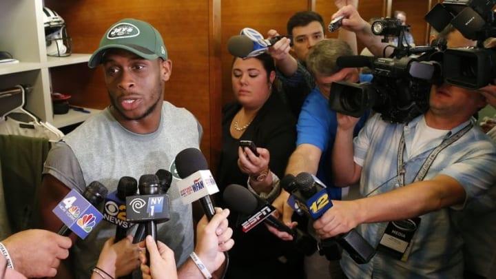 May 25, 2016; New York, NY, USA; New York Jets quarterback Geno Smith (7) responds to questions from media during OTA at Atlantic Health Training Center. Mandatory Credit: Noah K. Murray-USA TODAY Sports