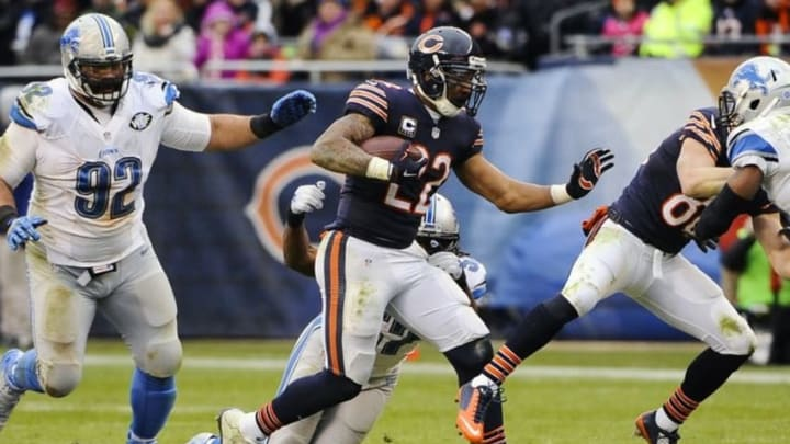 Jan 3, 2016; Chicago, IL, USA; Chicago Bears running back Matt Forte (22) runs against Detroit Lions outside linebacker Josh Bynes (57) and defensive tackle Haloti Ngata (92) in the second half of their game at Soldier Field. Mandatory Credit: Matt Marton-USA TODAY Sports