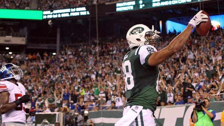 Aug 22, 2014; East Rutherford, NJ, USA; New York Jets tight end Jace Amaro (88) celebrates scoring a touchdown against the New York Giants during the second quarter at MetLife Stadium. Mandatory Credit: Adam Hunger-USA TODAY Sports