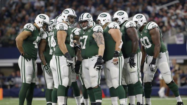Dec 19, 2015; Arlington, TX, USA; New York Jets players huddle during the game against the Dallas Cowboys at AT&T Stadium. Mandatory Credit: Kevin Jairaj-USA TODAY Sports