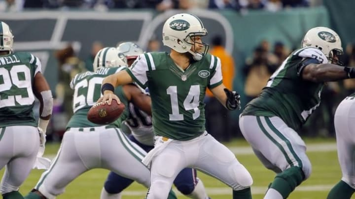 Dec 27, 2015; East Rutherford, NJ, USA; New York Jets quarterback Ryan Fitzpatrick (14) throws a pass during the third quarter of game against the New England Patriots at MetLife Stadium. New York Jets defeat the New England Patriots 26-20 in OT. Mandatory Credit: Jim O