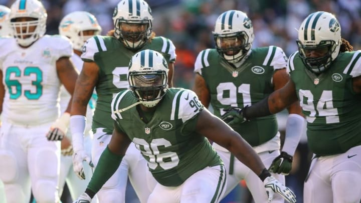 Nov 29, 2015; East Rutherford, NJ, USA; New York Jets defensive end Muhammad Wilkerson (96) celebrates his sack of Miami Dolphins quarterback Ryan Tannehill (not shown) during the first half at MetLife Stadium. Mandatory Credit: Ed Mulholland-USA TODAY Sports