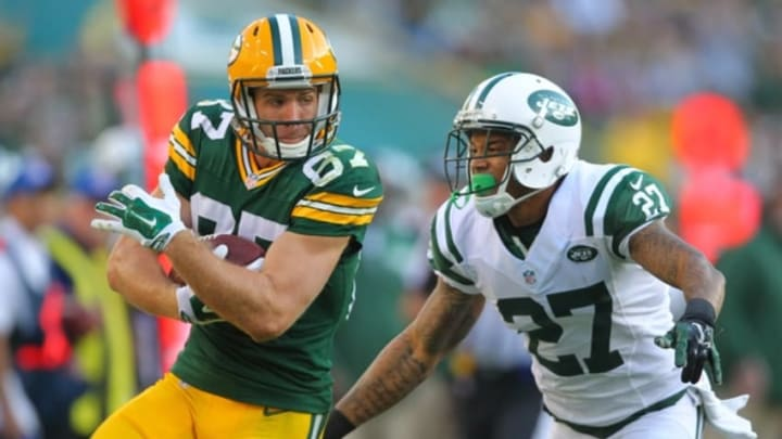 Sep 14, 2014; Green Bay, WI, USA; Green Bay Packers wide receiver Jordy Nelson (87) catches a 33 yard pass with New York Jets cornerback Dee Milliner (27) defending during the second half of a game at Lambeau Field. Green Bay won 31-24. Mandatory Credit: Dennis Wierzbicki-USA TODAY Sports