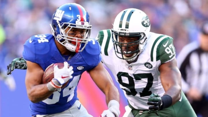 Dec 6, 2015; East Rutherford, NJ, USA; New York Giants running back Shane Vereen (34) runs by New York Jets linebacker Calvin Pace (97) during the fourth quarter at MetLife Stadium. The Jets defeated the Giants 23-20 in overtime. Mandatory Credit: Brad Penner-USA TODAY Sports
