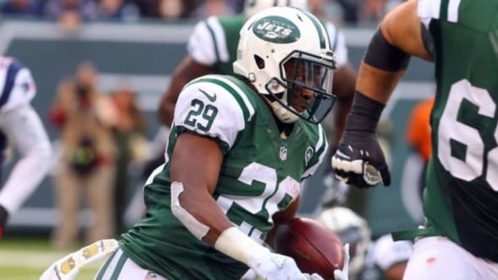Dec 27, 2015; East Rutherford, NJ, USA; New York Jets running back Bilal Powell (29) runs with the ball during the second half at MetLife Stadium. The Jets defeated the Patriots 26-20 in overtime. Mandatory Credit: Ed Mulholland-USA TODAY Sports