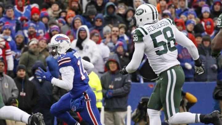 Jan 3, 2016; Orchard Park, NY, USA; Buffalo Bills wide receiver Sammy Watkins (14) runs after a catch as New York Jets linebacker Erin Henderson (58) pursues during the first half at Ralph Wilson Stadium. Mandatory Credit: Kevin Hoffman-USA TODAY Sports