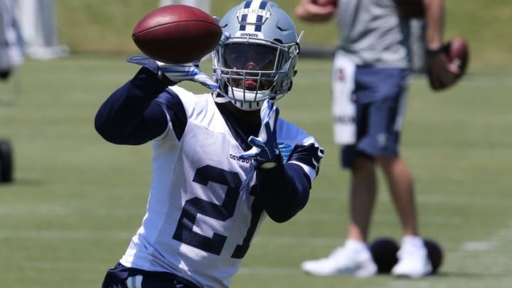 May 6, 2016; Irving, TX, USA; Dallas Cowboys number one draft pick Ezekiel Elliott (21) makes a catch during rookie minicamp at Dallas Cowboys headquarters at Valley Ranch. Mandatory Credit: Matthew Emmons-USA TODAY Sports