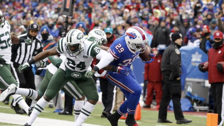 Jan 3, 2016; Orchard Park, NY, USA; New York Jets cornerback Darrelle Revis (24) knocks Buffalo Bills running back Karlos Williams (29) out of bounds after a run during the first half at Ralph Wilson Stadium. Mandatory Credit: Timothy T. Ludwig-USA TODAY Sports