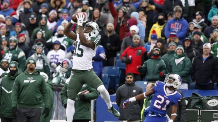 Jan 3, 2016; Orchard Park, NY, USA; New York Jets wide receiver Brandon Marshall (15) jumps to make a catch while being defended by Buffalo Bills strong safety Leodis McKelvin (21) during the first half at Ralph Wilson Stadium. Mandatory Credit: Timothy T. Ludwig-USA TODAY Sports