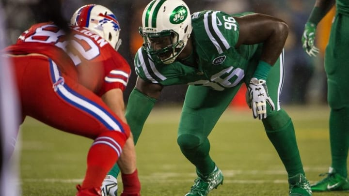 Nov 12, 2015; East Rutherford, NJ, USA; New York Jets defensive end Muhammad Wilkerson (96) lines up against Buffalo Bills tight end Matthew Mulligan (82) in the 1st quarter at MetLife Stadium. Mandatory Credit: William Hauser-USA TODAY Sports