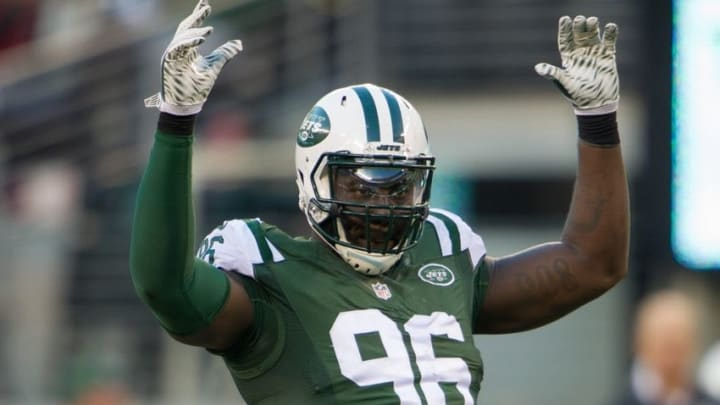 Nov 29, 2015; East Rutherford, NJ, USA; New York Jets defensive end Muhammad Wilkerson (96) reacts to the crowd in the second half of the Jets 38-20 victory over the Miami Dolphins at MetLife Stadium. Mandatory Credit: William Hauser-USA TODAY Sports